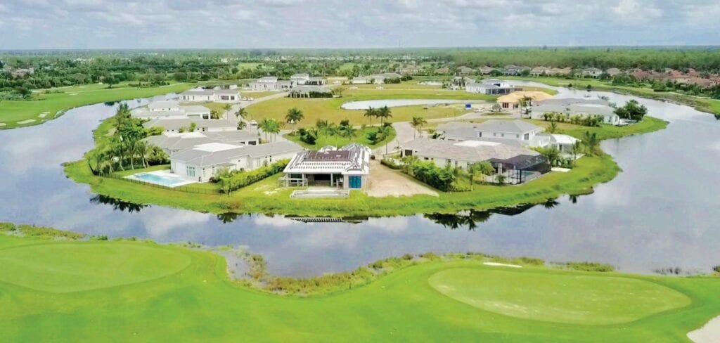 Every home in Peninsula Treviso Bay overlooks a lake and the finishing holes of the community's TPC golf course. Photo courtesy of Nick Ummarino Photography