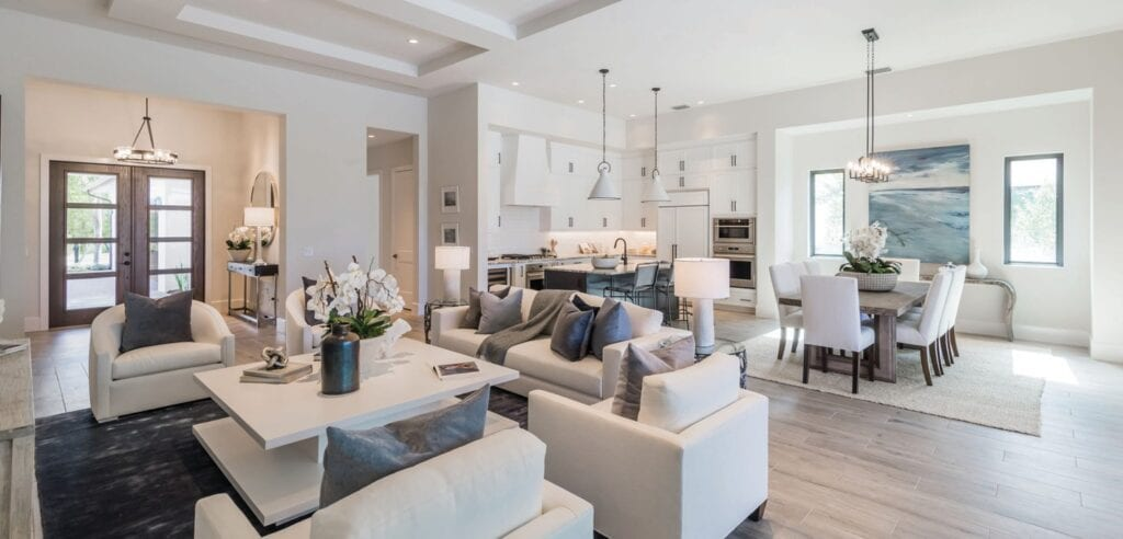 The 2,988-square-foot Devonshire planned inventory home offers an open-concept living area that includes a great room, white quartz waterfall island kitchen, wine storage, and a dining room.