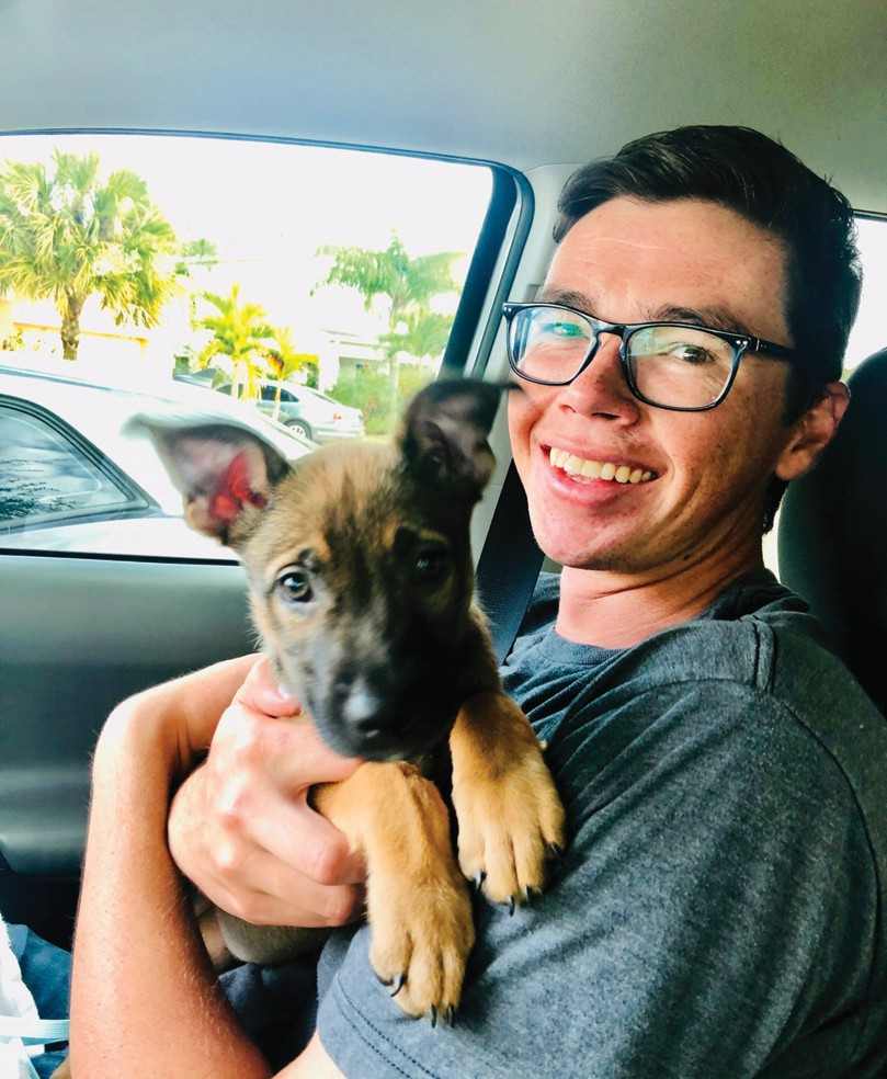 Garrison Smith with Lola on Valentine's Day 2020, the day he gave the shepherd mix puppy to his mom.